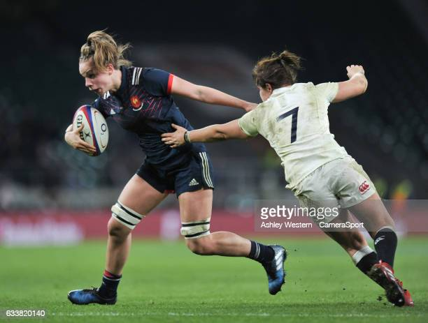 France Womens Romane Ménager evades the tackle of England Womens Marlie Packer during the Women's Six Nations match between England Women and France...