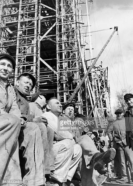 France World exhibition 1937 in Paris construction site of the German Pavillon building workers resting in the sun Photographer Hanns Hubmann...