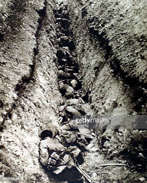 France World War I Corpses in a German trench A single machine gun raking the trench committed this massacre