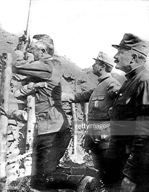 France World War I General Franchet d'Esperey visiting the trenches He is observing the enemy with a periscope