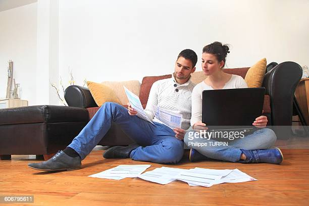 France, young couple at home