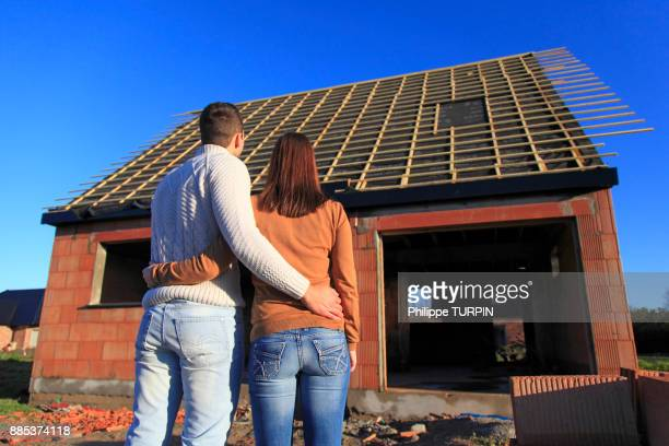 France, young person couples and house in construction.