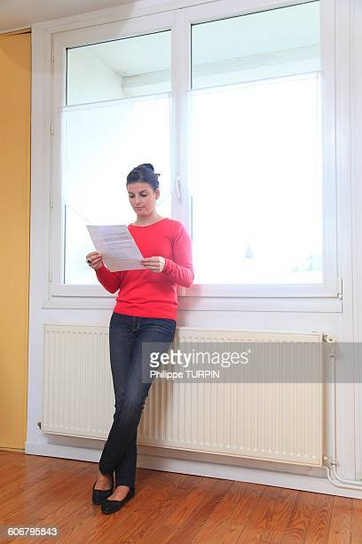 France, young woman and heating
