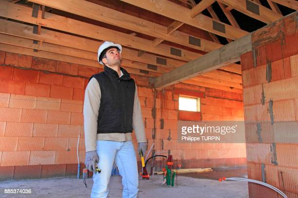 France, young working person in a house in construction.
