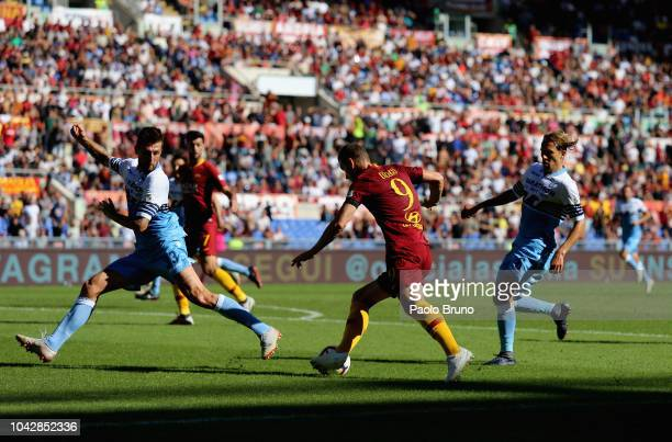 Franceco Acerbi of SS Lazio competes for the ball with Edin Dzeko of AS Roma during the Serie A match between AS Roma and SS Lazio at Stadio Olimpico...