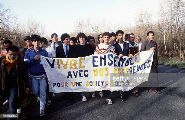 French Culture Minister Jack Lang walks with Tens of people many of them immigrant workers and their children 03 November 1983 between Beauvais and...