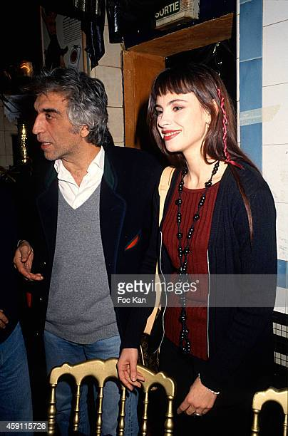 Gerard Darmon and Mathilda May attend a fashion week Party at Les Bains Douches in the 1990s in Paris France