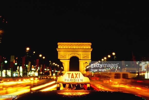 France,Paris,Arc de Triomphe,`Taxi' sign in foreground