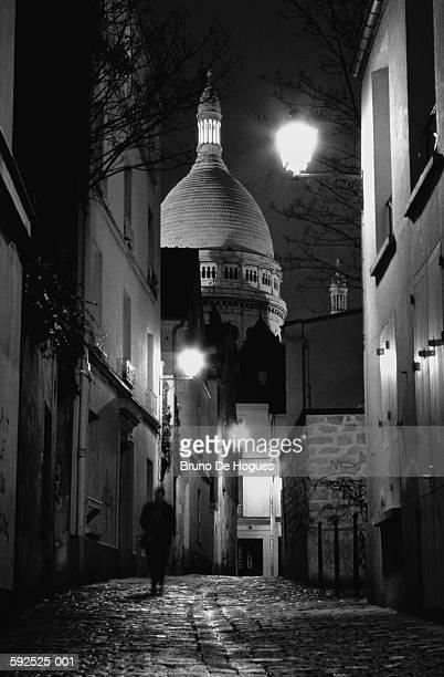 France,Paris,Montmartre,Sacre Coeur rising above buildings,night (B&W)