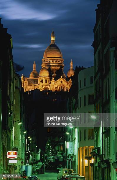 France,Paris,Montmartre,Sacre-Coeur illuminated at night,street in for