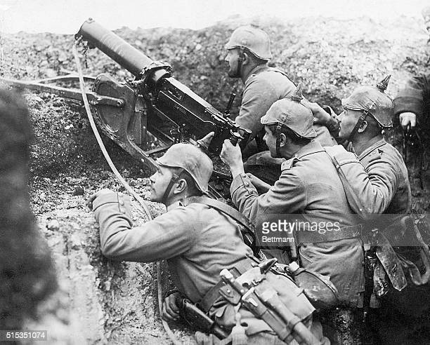 France-Photo shows a German machine gun in use in a trench near Reims, sending a steady stream of load into the advance trenches of the French troops.