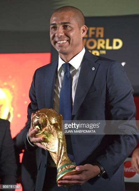 France's 1998 World Cup Champion and former footballer David Trezeguet holds the FIFA World Cup trophy in Ezeiza Buenos Aires on March 29 during the...