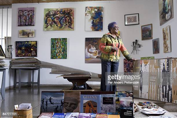 Frances Ademoa an art gallery owner stands in her showroom with local art on June 13 2008 in central Accra Ghana Mrs Ademoa hopes to increase her...