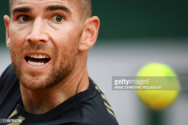 France's Adrian Mannarino eyes the ball as he plays against Italy's Stefano Travaglia during their men's singles first round match on day three of...