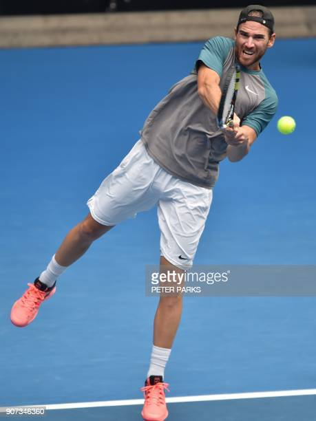 France's Adrian Mannarino hits a return against Austria's Dominic Thiem during their men's singles third round match on day six of the Australian...
