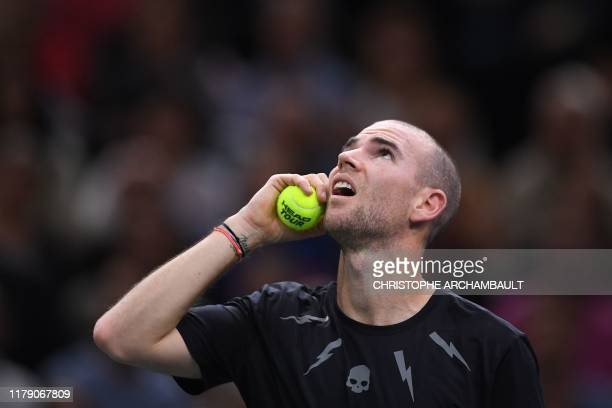 France's Adrian Mannarino looks up to the scoreboard during his match against Spain's Rafael Nadal during their men's singles tennis match on day...