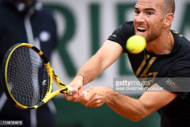 France's Adrian Mannarino plays a backhand return to Italy's Stefano Travaglia during their men's singles first round match on day three of The...