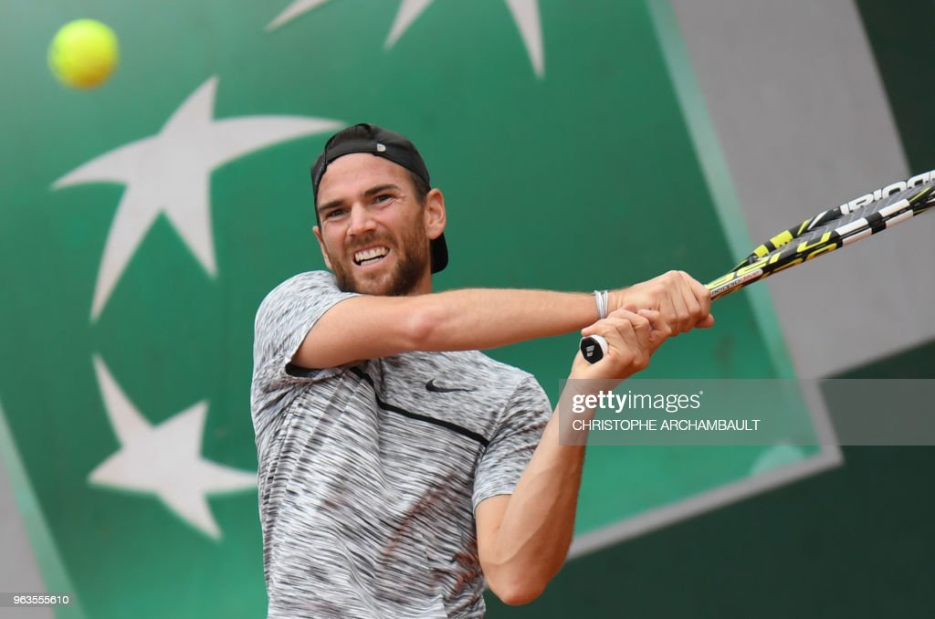 France's Adrian Mannarino plays a return to Steve Johnson of the US during their men's singles first round match on day three of The Roland Garros 2018 French Open tennis tournament in Paris on May 29, 2018.