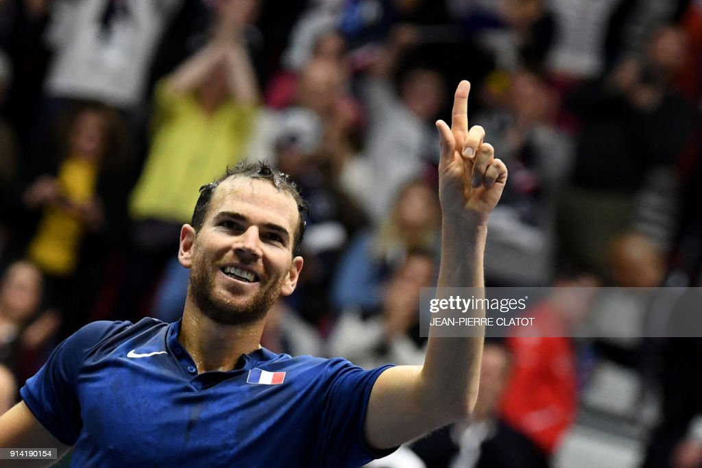 TOPSHOT - France's Adrian Mannarino reacts after winning his singles tennis match against the Netherlands' Robin Haase as part of the Davis Cup World Group first round match between France and Netherlands in Albertville on February 4, 2018. /