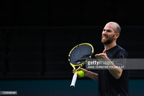 France's Adrian Mannarino reacts as he plays against Germany's Alexander Zverev during their men's singles round of sixteen tennis match on day 4 at...