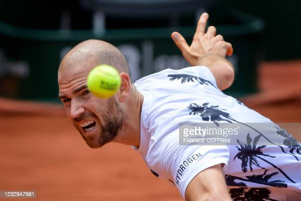France's Adrian Mannarino returns a ball to compatriot Arthur Cazaux during their match on the second day of the ATP250 Geneva Open tennis tournament...