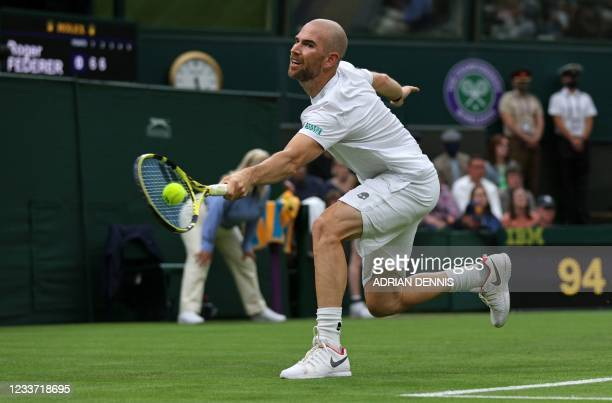 France's Adrian Mannarino returns against Switzerland's Roger Federer during their men's singles first round match on the second day of the 2021...