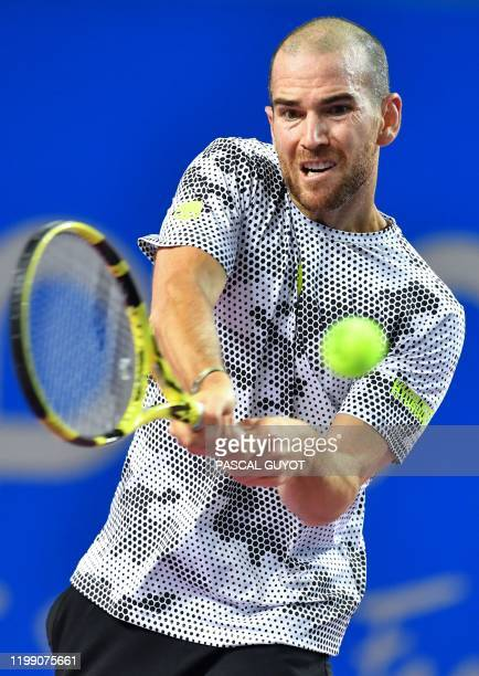 France's Adrian Mannarino returns the ball to France's Gael Monfils during their singles tennis match at the Open Sud de France ATP World Tour in...
