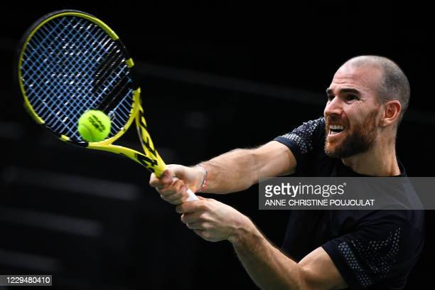 France's Adrian Mannarino returns the ball to Germany's Alexander Zverev during their men's singles round of sixteen tennis match on day 4 at the ATP...