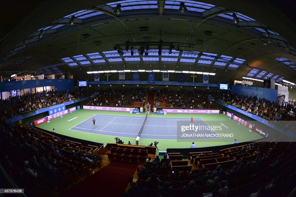 France's Adrian Mannarino (L) returns the ball to Germany's Matthias Bachinger during their ATP Stockholm Open tennis tournament match on October 17, 2014 in Stockholm.