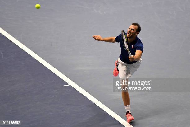TOPSHOT France's Adrian Mannarino returns the ball to Netherlands' Robin Haase during their tennis match as part of the Davis Cup World tie between...