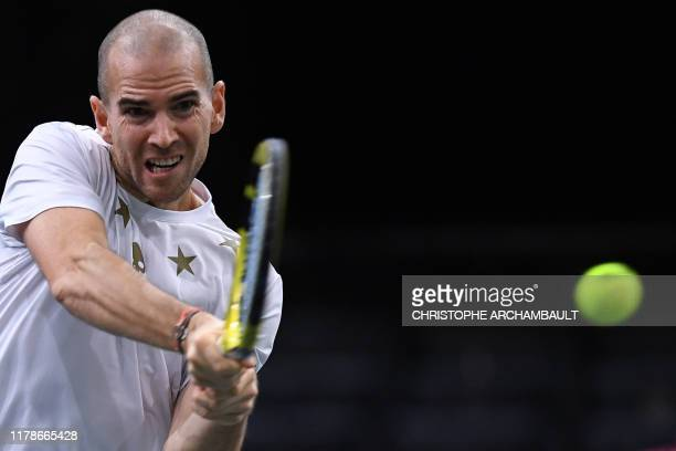 TOPSHOT France's Adrian Mannarino returns the ball to Norway's Casper Ruud during their men's singles tennis match on day one of the ATP World Tour...