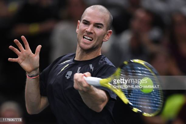 France's Adrian Mannarino returns the ball to Spain's Rafael Nadal during their men's singles tennis match on day three of the ATP World Tour Masters...