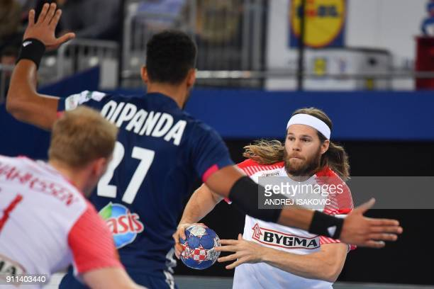 France's Adrien Dipanda defends against Denmark's Mikkel Hansen during the match for third place of the Men's 2018 EHF European Handball Championship...