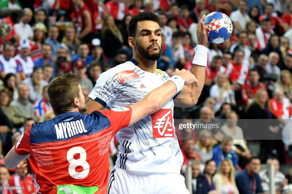 France's Adrien Dipanda (R) vies with Norway's Bjarte Myrhol during the preliminary round group B match of the Men's 2018 EHF European Handball Championship between France and Norway in Porec, Croatia on January 12, 2018. /