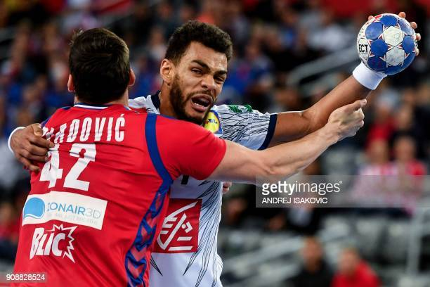 TOPSHOT France's Adrien Dipanda vies with Serbia's Nemanja Obradovic during their group I match of the Men's 2018 EHF European Handball Championship...