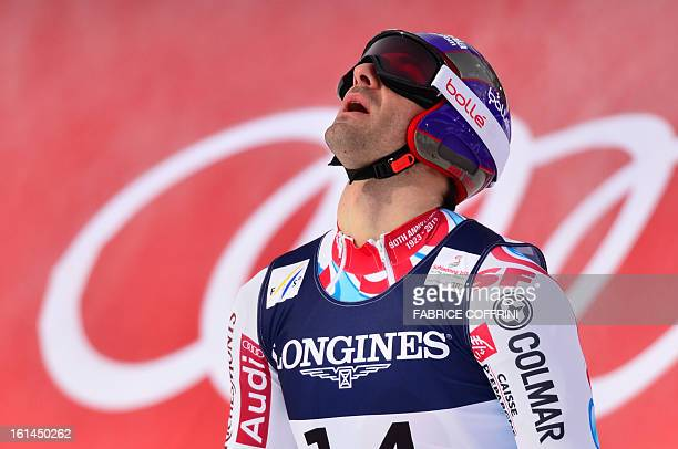 France's Adrien Theaux finishes the downhill event during the men's super combined at the 2013 Ski World Championships in Schladming Austria on...