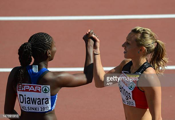 France's Aisseta Diawara and Belgian's Eline Berings greet each other after the women's 100m hurdles qualifications at the 2012 European Athletics...