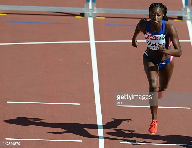 France's Aisseta Diawara competes in the women's 100m hurdles qualifications at the 2012 European Athletics Championships at the Olympic Stadium in...
