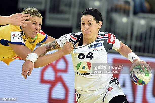 France's Alexandra Lacrabere vies with Sweden's Johanna Ahlm during the Main Round Group 2 match Sweden vs France of the 2014 Women's European...