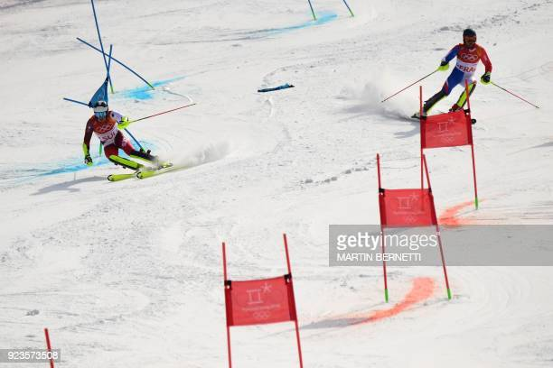 France's Alexis Pinturault and Switzerland's Daniel Yule compete in the Alpine Skiing Team Event semifinals at the Jeongseon Alpine Center during the...