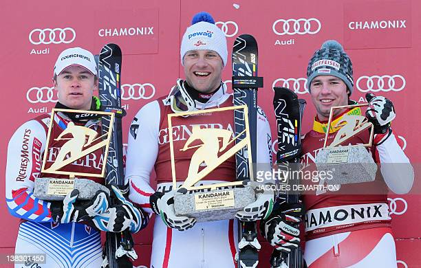 France's Alexis Pinturault Austria's Romed Baumann and Switzerland's Beate Feuz pose on the podium with their awards after the Kandahar Men's Super...