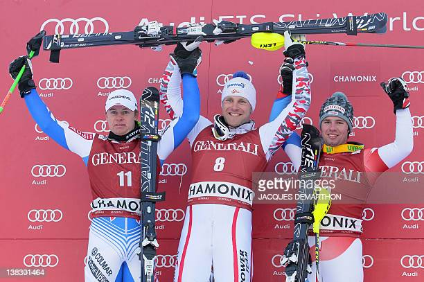 France's Alexis Pinturault Austria's Romed Baumann and Switzerland's Beate Feuz celebrate on the podium with their awards after the Kandahar Men's...