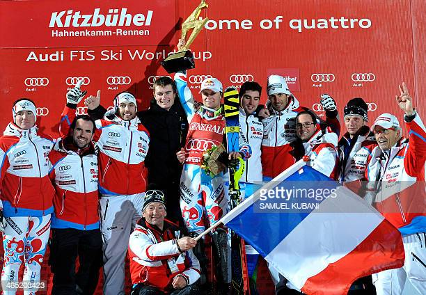 France's Alexis Pinturault celebrates with his trophy and France's team on podium on January 26 2014 after the FIS men's Alpine ski World Cup Super...
