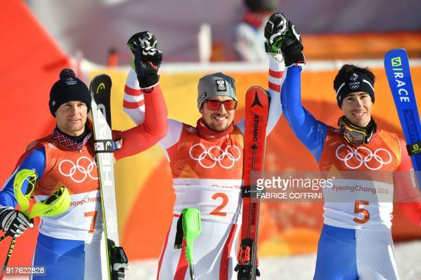 TOPSHOT France's Alexis Pinturault silver medal Austria's Marcel Hirscher gold and France's Victor MuffatJeandet bronze celebrate in the finish area...