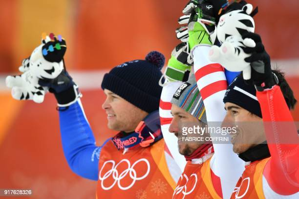 France's Alexis Pinturault silver medal Austria's Marcel Hirscher gold and France's Victor MuffatJeandet bronze celebrate on the podium during the...