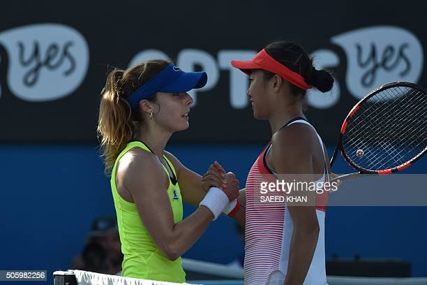 France's Alize Cornet and China's Zhang Shuai shake hands after Zhang won their women's singles match on day four of the 2016 Australian Open tennis...
