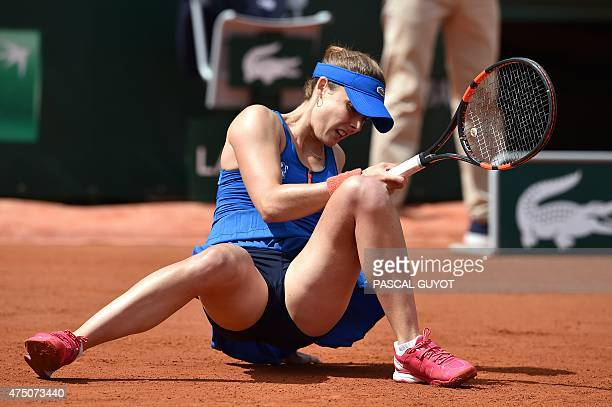 France's Alize Cornet falls during her match against Croatia's Mirjana LucicBaroni during the women's third round at the Roland Garros 2015 French...