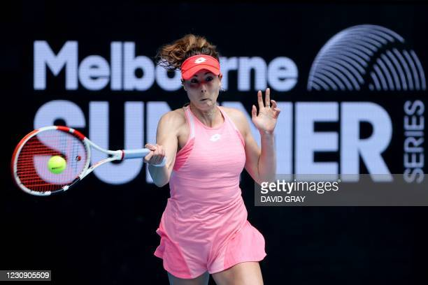 France's Alize Cornet hits a return against Australia's Ajla Tomljanovic during their Gippsland Trophy women's singles tennis match in Melbourne on...