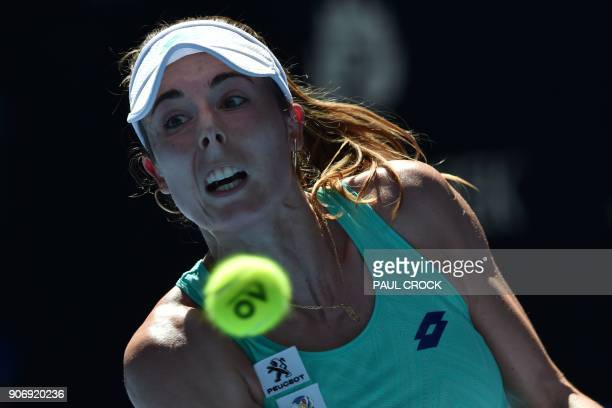 France's Alize Cornet hits a return against Belgium's Elise Mertens during their women's singles third round match on day five of the Australian Open...