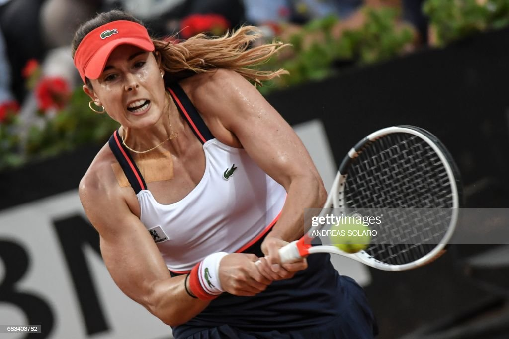 TOPSHOT - France's Alize Cornet hits a return to Italy's Sara Errani, during the ATP Tennis Open tournament in Rome at the Foro Italico, on May 15, 2017. SOLARO